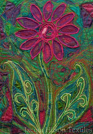 """A Study in Emerald"" finished textile piece: pink flower with bright green leaves on a green background embroidered with red thread."